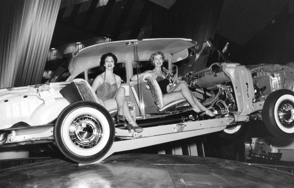 A sultry scene from the 1955 auto show