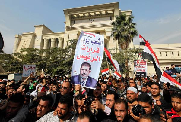 Egyptian supporters of the Muslim Brotherhood rally in support of Islamist President Mohamed Morsi in Cairo. The president and the judiciary have clashed over the nation's draft constitution.