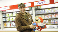 "At GameStop Kids at White Marsh Mall, shoppers will find plush Mario book bags and Angry Birds hats mixed in with the Lego Star Wars and other kid-friendly video games, a mix meant to attract both serious ""gamers"" as well as those who've never played but want some gift-giving advice."