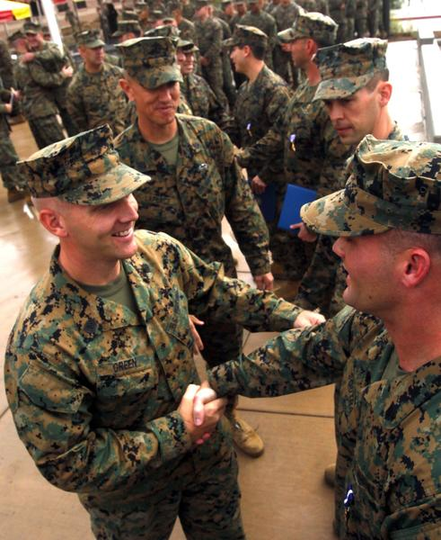 Marine Sgt. William B. Soutra, right, is congratulated by fellow Marines after being awarded the Navy Cross during ceremonies at the 1st Marine Special Operations Battalion at Camp Pendleton.