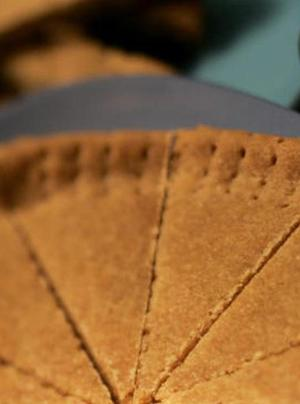 "Brown sugar shortbread has caramel and molasses notes. This recipe makes enough dough for two pans of cookies, so you can try a pan of each variety if you'd like. Because they're baked in pans, the wedge cookies will retain more moisture, giving the cookies a chewy texture. Conversely, the bar cookies will be crisp because they are baked on an open, flat sheet. <a href=""http://www.latimes.com/features/la-fo-shortbreadrec4a-2009feb04,0,4054172.story"">Click here for the recipe.</a>"