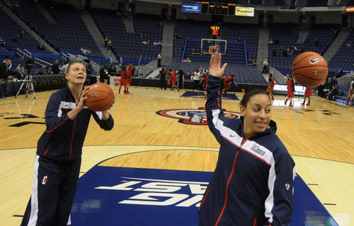 Heather Buck, left, and Bria Hartley warm up with their teammates before UConn's game against Maryland Monday at the XL Center.