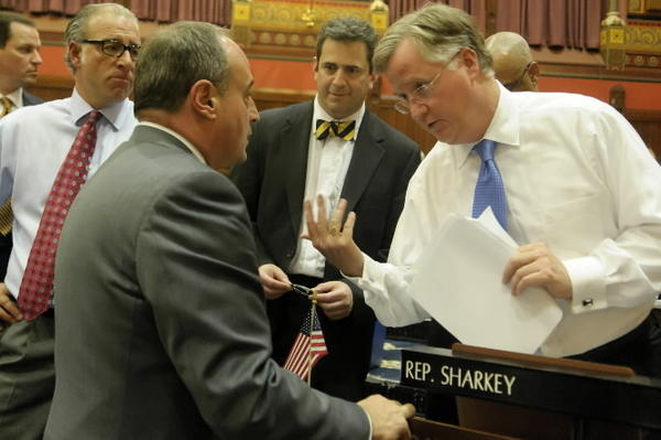 Democratic Reps. Antonio Guerrera and Chris Perone look on as House Minority Leader Larry Cafero confers with Majority Leader Brendan Sharkey on the last day of the 2012 Connecticut legislative session in early May.