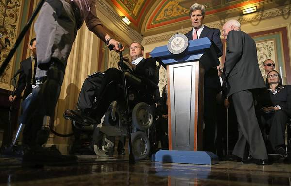 Senate Foreign Relations Chairman John Kerry, D-Mass., at lectern, and Sen. John McCain, R-Ariz., at right, participate in a Monday news conference with people with disabilities. Kerry and McCain back ratification of a U.N. treaty on the rights of people with disabilities.