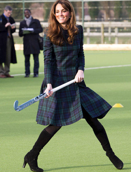 Catherine, Duchess of Cambridge, playing hockey with students Friday during her visit to St Andrew's School in Pangbourne, Berkshire, England.
