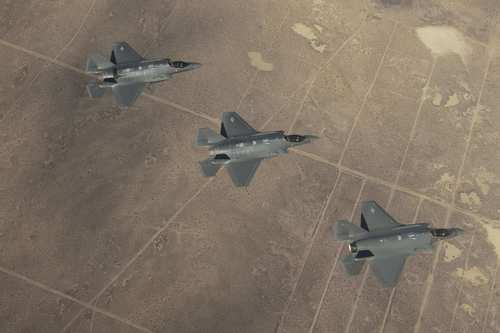 F-35 fighter jets fly over Edwards Air Force Base in December. The F-35 has been delayed by glitches with its onboard computer systems, cracks in structural components and troubles with its electrical system.
