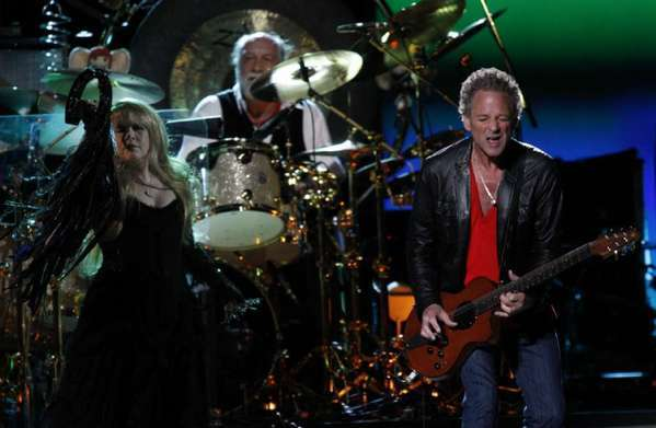 Stevie Nicks and Lindsey Buckingham with Mick Fleetwood on drums at the Honda Center in Anaheim in 2009.