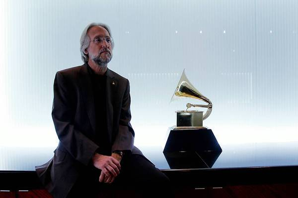 Recording Academy President Neil Portnow says that the Grammy rule changes, announced in 2011, were critical because the number of trophies had ballooned unreasonably.