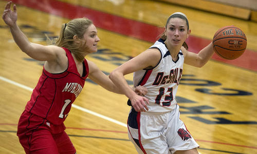 DeSales guard Sondrine Glovas (13) drives to the basket against Muhlenberg guard Colleen Caldwell (11) in their Women's Basketball game at DeSales University in Center Valley on Monday.
