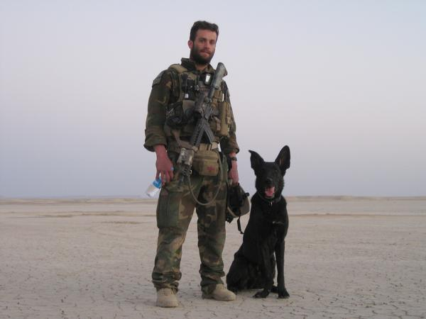 Marine Sgt. William Soutra and his working dog, Posha, in Afghanistan. The German shepherd was with the Marines when they landed in a helicopter-borne assault to clear out a Taliban command post and quickly found two pressure-plate bombs on the main route to the Taliban compound. Posha was later diagnosed with cancer and had to be euthanized last year.