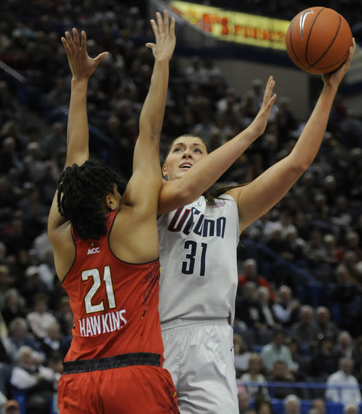 UConn's Stefanie Dolson shoots over Maryland forward Tianna Hawkins in the first half. Dolson had team highs of 14 points and eight rebounds in the 63-48 win over Maryland.