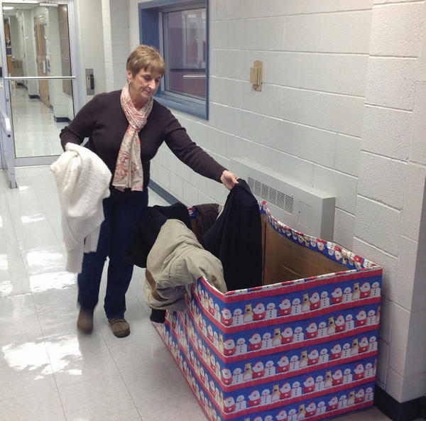 Fran Britsch, member services director at the Waynesboro (Pa.) Area YMCA, sorts coats for the YMCA's coat drive, which is part of the 12 Days of Christmas.