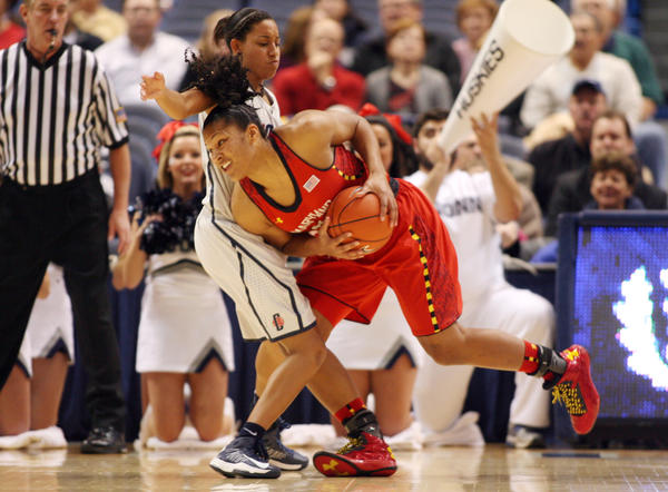 Maryland's Alyssa Thomas tries to get past UConn's Bria Hartley in the first half.