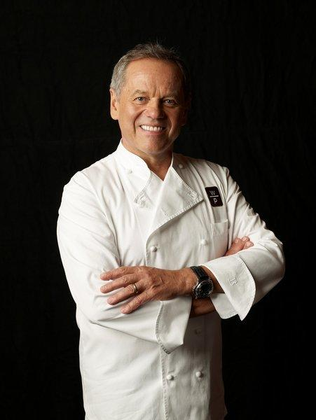 Wolfgang Puck is celebrating two decades of work in Las Vegas, turning up the volume -- way up -- on the dining scene.