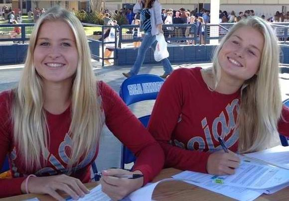 Corona del Mar High's Stephania Haralabidis (USC women's water polo) and Ionna Haralabidis (USC women's water polo) smile during a signing ceremony at CdM.