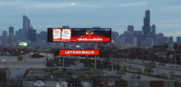 An electronic billboard glows last month along the Kennedy Expressway near Logan Boulevard and Western Avenue. A contract being considered by aldermen would allow nearly three dozen digital billboards to be placed on city property next to expressways.