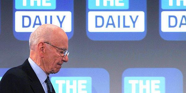 The Daily will cease publication Dec. 15. Some of its staff will be moved to the New York Post. Above, News Corp. CEO Rupert Murdoch walks on stage at the Guggenheim Museum in New York last year for the news app's launch.