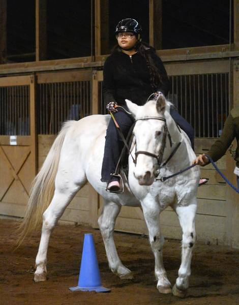 Kiana Roman, 13, of Easton, takes her horseback riding lesson on Timmy, at Equi-librium in Snydersville. Kiana is an 8th grader at Nazareth Middle School and is autistic. Assisting her with Timmy is Jacob Weller, 14, of Bartonsville.