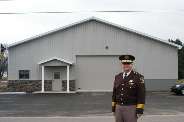 Charlevoix County Sheriff Don Schneider stands in front of the recently completed sheriff substation in Boyne Falls.