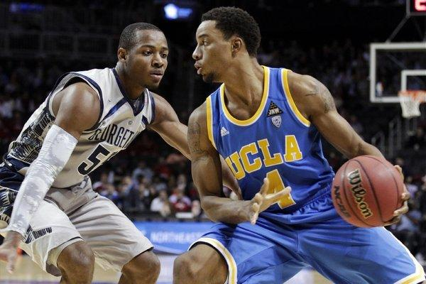 UCLA's Norman Powell protects the ball from Georgetown's Jabril Trawick in the first half of their game on Nov. 19.