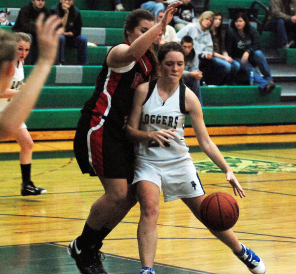 Boyne Falls junior Charlene Bearss (right) drives into the lane as Bellaire junior Gillian Nevarez defends during Mondays non-league contest at the Boyne Falls High School gym. The Eagles defeated the Loggers, 59-41, in Bellaires season opener, while Boyne Falls drops to 2-1.