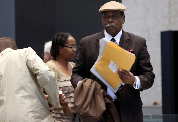 Cook County Commissioner William Beavers arrives at the Dirksen U.S. Courthouse in Chicago today.
