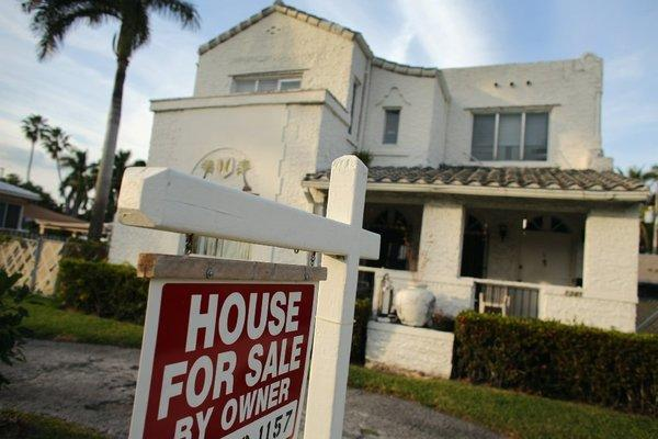 A 'For Sale' sign is posted in front of a house in Hollywood, Fla., in November.