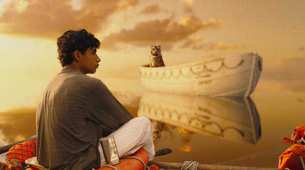 "Pi (Suraj Sharma) and a Bengal tiger known as Richard Parker arrive at an uneasy detente in director Ang Lees ""Life of Pi."""