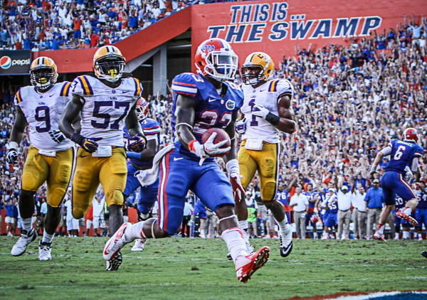ida running back Mike Gillislee (23) slips through a pocket in the LSU defense and breaks away to score a touchdown as quarterback Jeff Driskel (6) reacts in the background during third quarter action of their game against LSU at Ben Hill Griffin Stadium on Saturday, October 06, 2012 in Gainesville, FL.