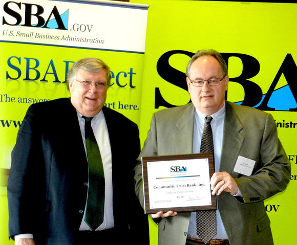 "Ralph Ross, left, district director for the U. S. Small Business Administration in Kentucky, recently presented Community Trust Bank with the ""Gold Lender Award."" Terry Spears, SBA Small Business Banking Officer for Community Trust, accepted the honor on behalf of the bank."