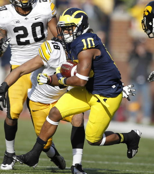 Michigan's Jeremy Gallon picks up a first down after a pass reception in the second quarter against Iowa in Ann Arbor, Michigan on Saturday, November 17, 2012. The Michigan Wolverines defeated the Iowa Hawkeyes, 42-17.