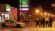At least 11 people were shot and wounded across Chicago Monday night and Tuesday morning, including five people in front of a currency exchange and an off-duty Cook County corrections officer on his way home from work, officials said.