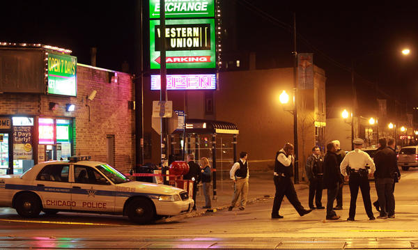 Chicago Police respond to a shooting near a currency exchange in the 7500 block of South Exchange Avenue at about 5:45 p.m., on Monday. Bullets struck five people, who range in age from 23 to 44 years old, Chicago Police Department said.