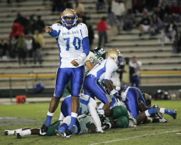 Mainland's Leonard Williams (70) reacts after Mainland recovered a fumble Friday, November 5, 2010, at Spec Martin Stadium in DeLand, Florida. A few plays before DeLand claimed a Mainland fumble. DeLand High School played Mainland High School for the Class 6A, District 2 football title.