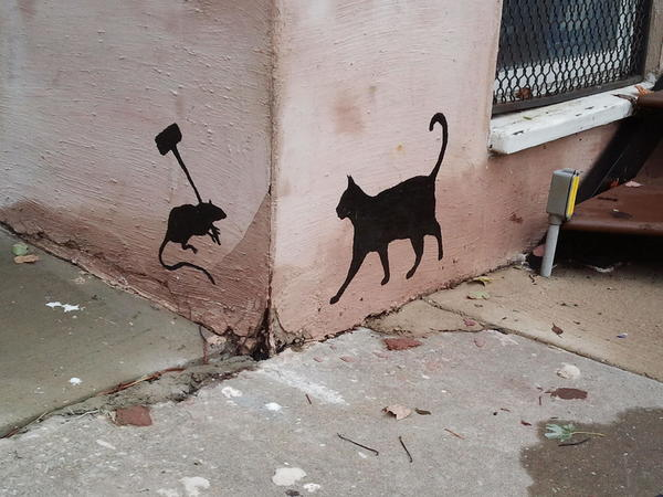 Painted in honor of a rat-killing cat, Midnight, in Butchers Hill.