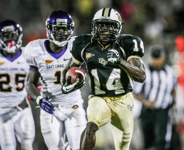 University of Central Florida wide receiver Quincy McDuffie (14) hauls in a pass and runs for 64 yards during third quarter action of a C-USA football game against East Carolina at the Brighthouse Networks Stadium on Thursday, October 04, 2012 in Orlando, FL.