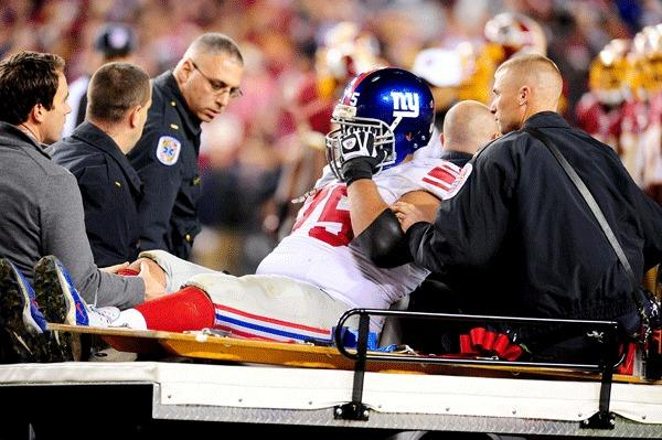 New York Giants offensive lineman Sean Locklear (75) gets carted off the field during the game against the Washington Redskins at FedEx Field.