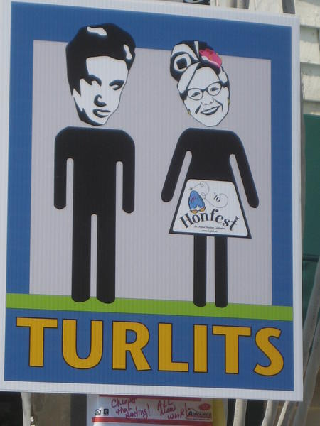 Restroom sign at Honfest. Still unclear: Whether this makes the prospect of public restrooms more appealing.