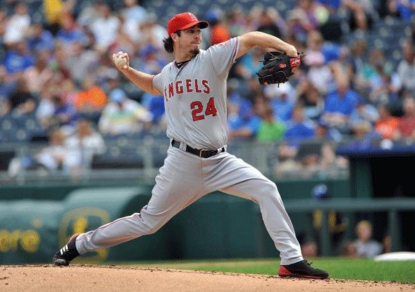 Los Angeles Angels pitcher Dan Haren (24) delivers a pitch against the Kansas City Royals during the first inning at Kauffman Stadium.