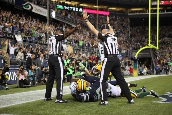 The moment the NFL's replacement referees lost their jobs came at the conclusion of a Monday Night Football game between the Packers and the Seahawks when a Hail Mary pass into the endzone that appeared to be an obvious interception was ruled a touchdown. The refs both signaled different things and the internet exploded.