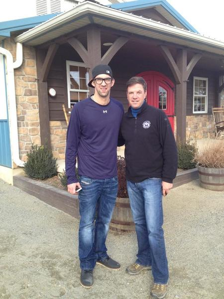 Olympic legend Michael Phelps poses with trainer Graham Motion, who guided Animal Kingdom to a victory in the 2011 Kentucky Derby, in Elkton.