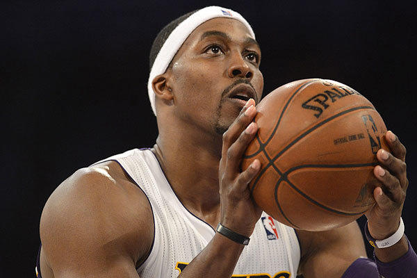 Dwight Howard of the Los Angeles Lakers shoots a free throw during the second half of a game against the Orlando Magic at Staples Center in L.A.