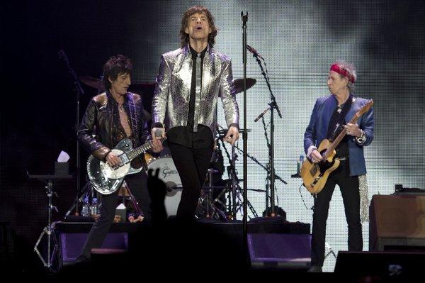 Rolling Stones Ron Wood, left, Mick Jagger and Keith Richards perform at a concert in London on Nov. 29, 2012, marking the iconic British band's 50th anniversary.