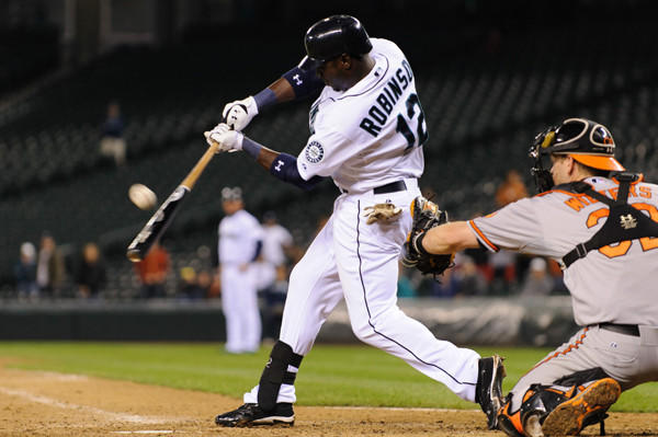 The Orioles acquired outfielder Trayvon Robinson from Seattle for infielder Robert Andino.