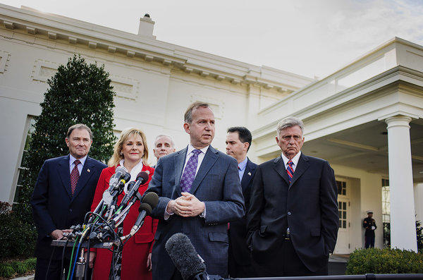 Democrat Jack Markell, governor of Delaware, speaks while Republican Govs. Gary Herbert of Utah, left, Mary Fallin of Oklahoma, second from left, and Scott Walker of Wisconsin, second from right, listen with Democratic Govs. Mark Dayton of Minnesota, third from left, and Arkansas Gov. Mike Beebe.