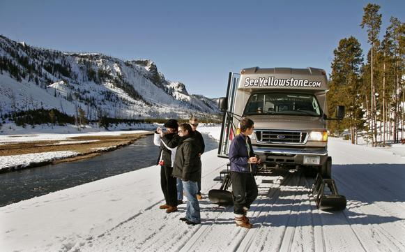 During the winter in Yellowstone, the crowds are gone and visitors can be numbered in the hundreds, nearly all of them in snowcoaches, on snowmobiles or