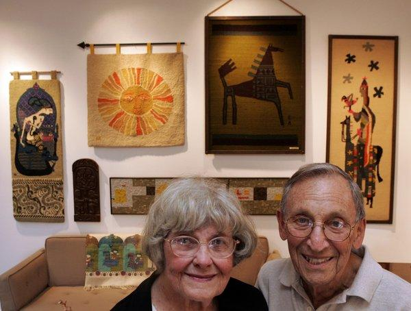 Evelyn Ackerman -- midcentury mosaic artist, textile designer and creator of works in ceramics, enamel and wood -- is shown with husband Jerry in this 2005 photo at Reform Gallery. More recently, her designs have been finding an audience among a new generation of curators and collectors drawn to the spirit that infuses her work, no matter the medium.
