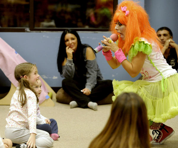 "Twinkle, right, sings to seven-year-old Tara Rose Brennan and her three-year-old sister Grace, left, as they enjoy themselves during a Twinkle Time Concert, featuring ""Twinkle and Her Friends!"" at Caterpillar Kids Place on Friday, Nov. 30, 2012."