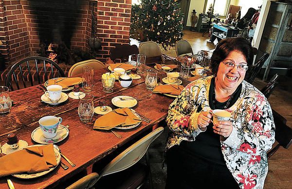 Jewel Rosenberry takes a break from preparing tea and a four-course meal for 18 guests Friday evening. Rosenberry opened a tea room, Annies Country Fixins', in her St. Thomas, Pa.-area home last year.