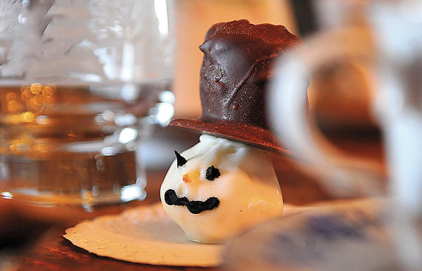 Jewel Rosenberry included this party favor, a marshmallow-and-chocolate snowman confection for guests, at a recent tea at her home-based business, Annie's Country Fixins'.